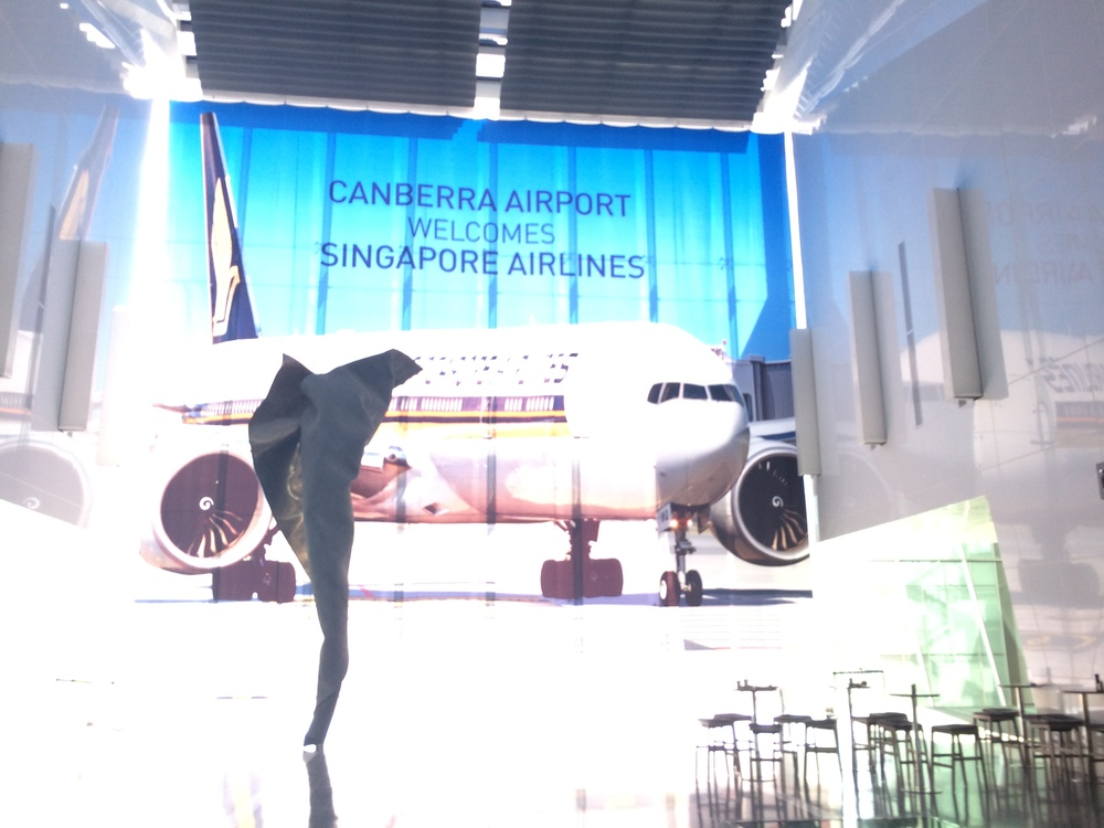 CBR Airport welcomes Singapore Airlines banner in terminal.