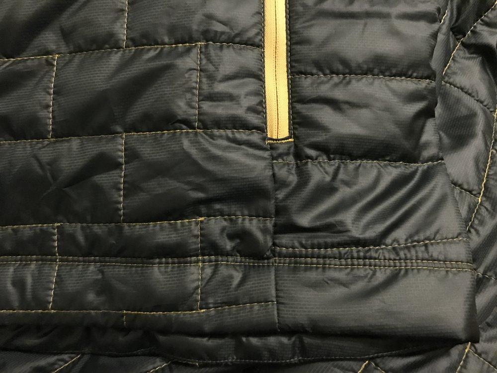 Seam repair on a Nano Puff jacket