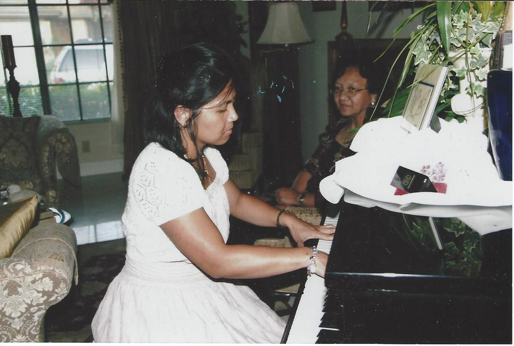 Dragged to the piano to play and not allowed off until the aunts and uncles are happy - if it can happen to me, it can happen to you! Photo: Jun Ancheta.