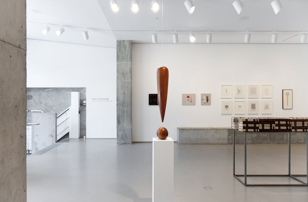 The renowned American artist  Richard Artschwager  sculpts words and translates perceptions into tangible objects. A former scientist and furniture maker, Artschwager re-contextualizes everyday objects into letters or punctuations suspended in space, creating new form from traditional visual representations of language. The exclamation point featured in the exhibition represents the arbitrary relationship between form and meaning, and reinstates the artist's dedication to playfully challenging the preconceived associations in language.