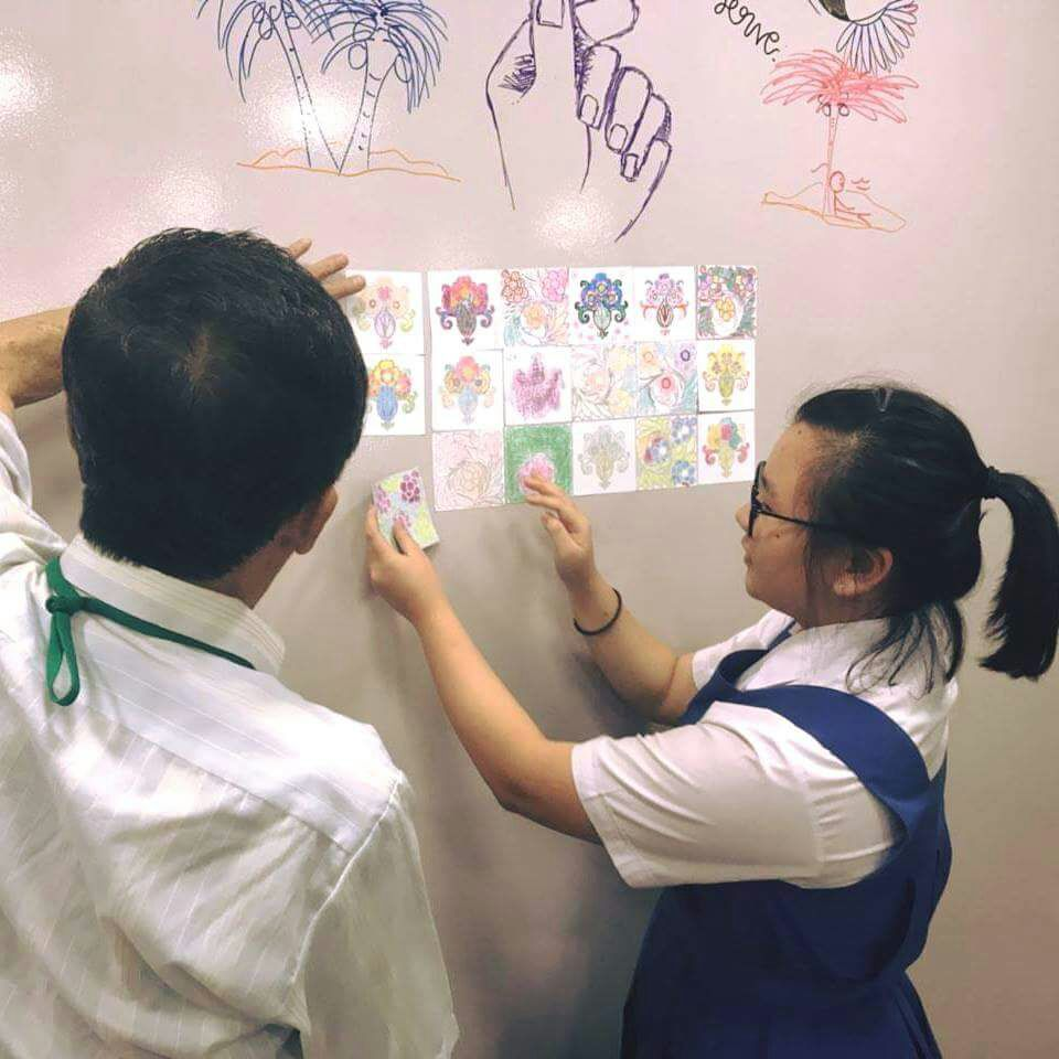Placing of specially coloured peranakan tiles on our 'Heritage Wall'