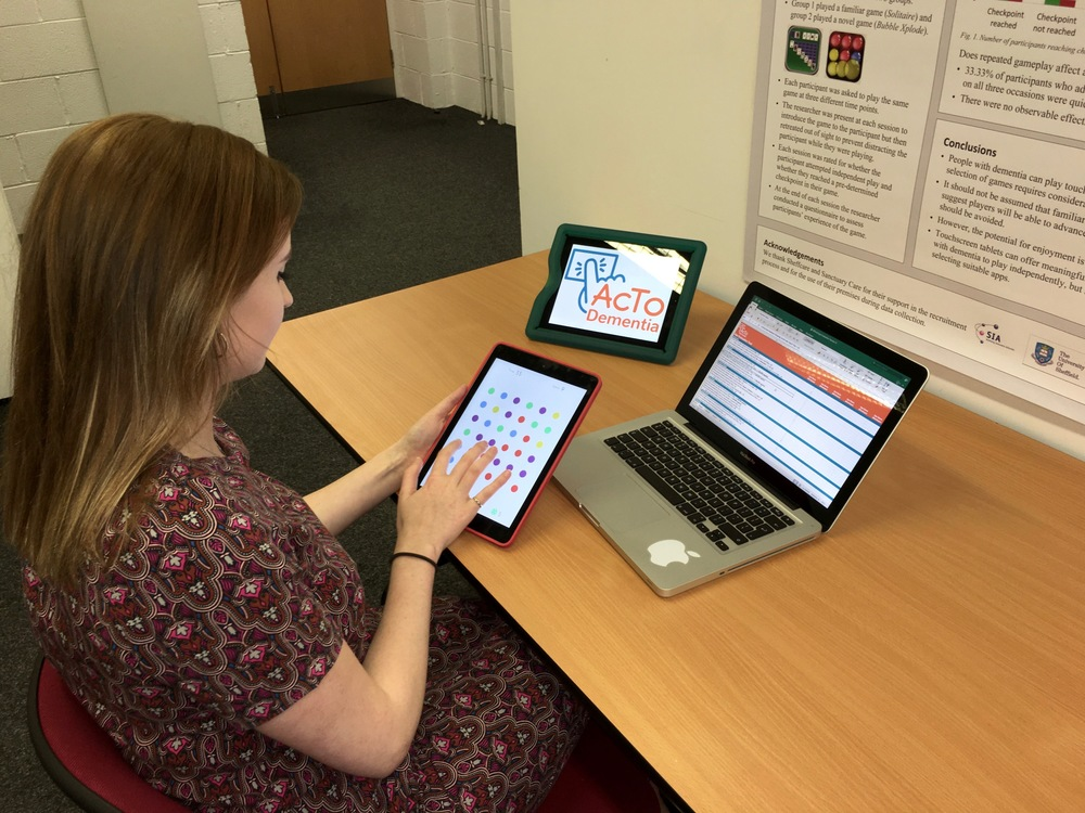 Elana Moore reviewing dementia friendly app Dots (by Playdots Inc.)