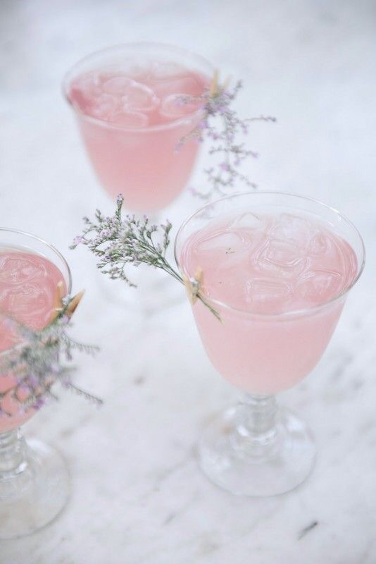 Rose water Cointreau fizz cocktails with a floral garnish