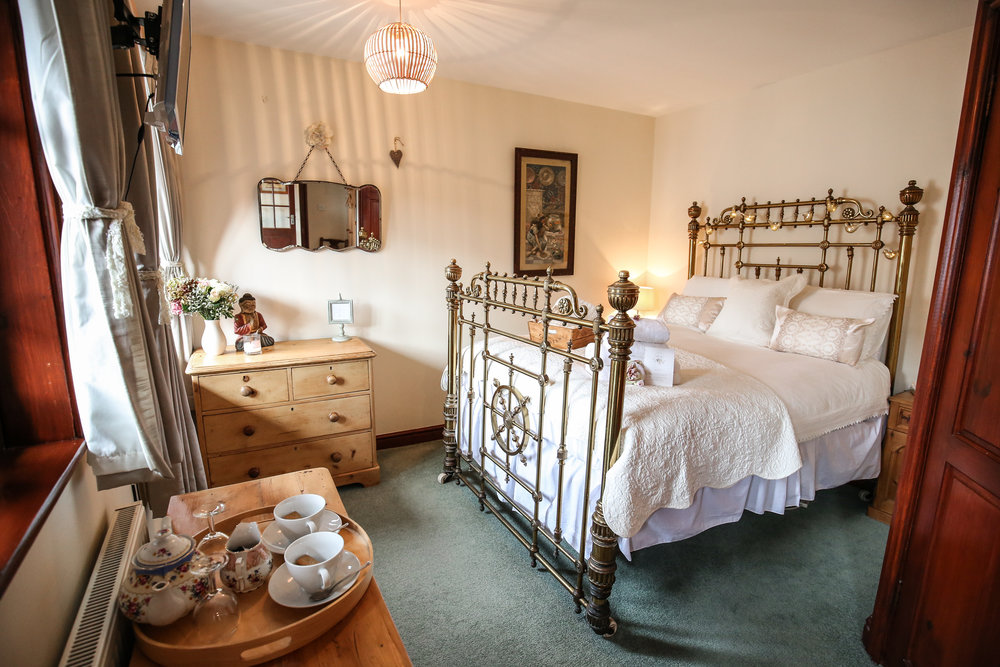 Room 3 - Room 3 is a balcony room, overlooking the garden with distinct nautical charm. It's gorgeous brass captain's bed makes a grand statement, the en-suite featuring both bath and shower. A perfect room for starcrossed lovers.