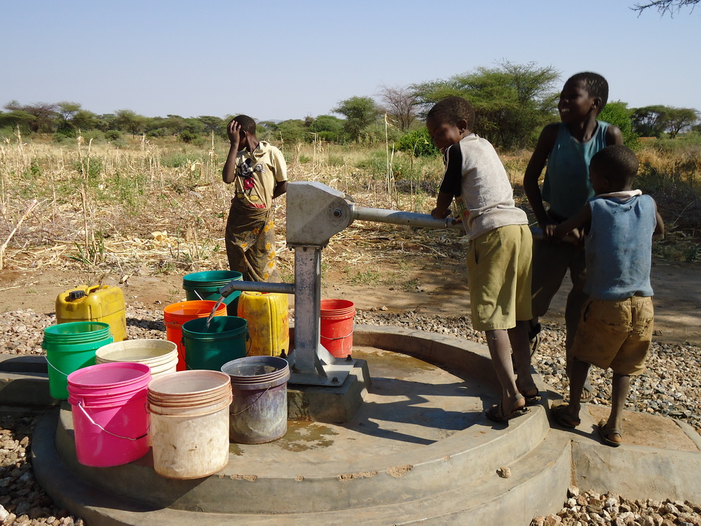 Excited children at a Waterpump in larghanga village in Yaeda chini mbulu.JPG