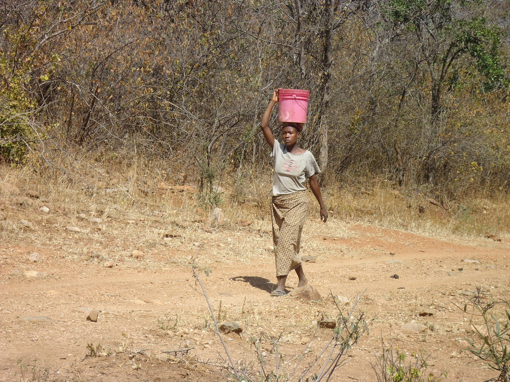 Woman carrying water.JPG