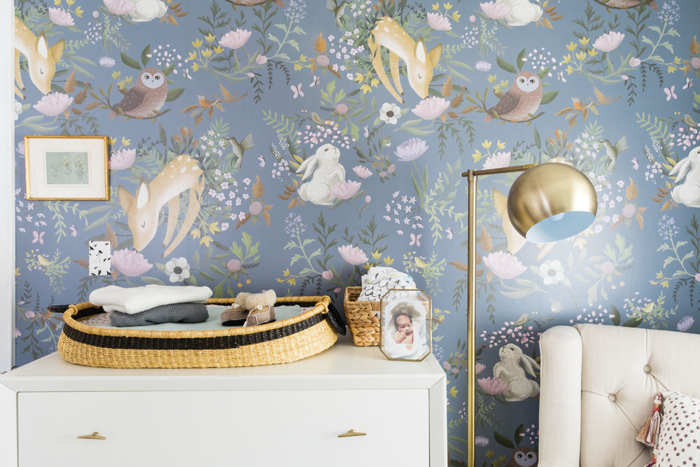 wallpaper  /  dresser  /  gold knobs  /  changing basket  /  floor lamp  /  rocker  /  pillow