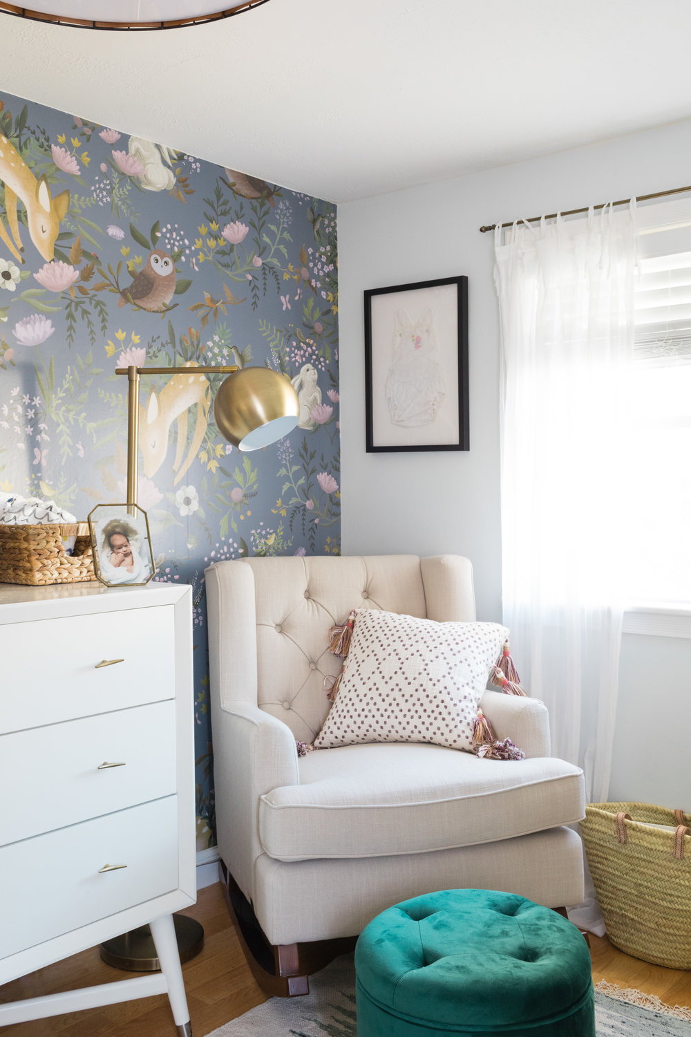 wallpaper  /  dresser  /  gold knobs  /  floor lamp  /  rocker  /  pillow  /  frame  /  curtains