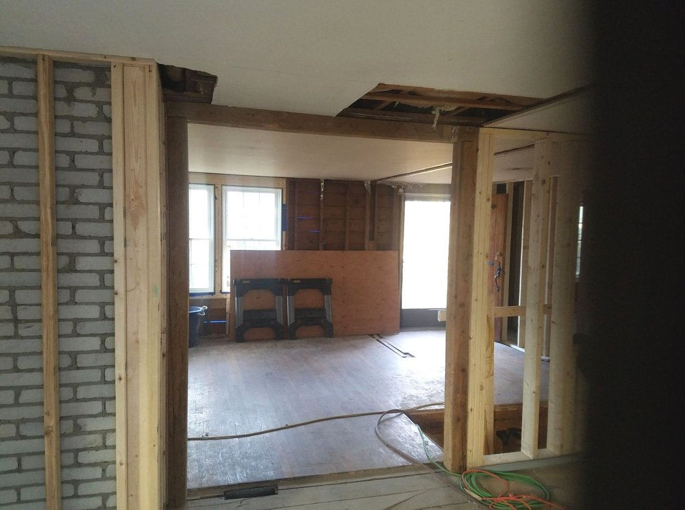 a more recent photo showing the wraparound beams heading towards the kitchen/living room.