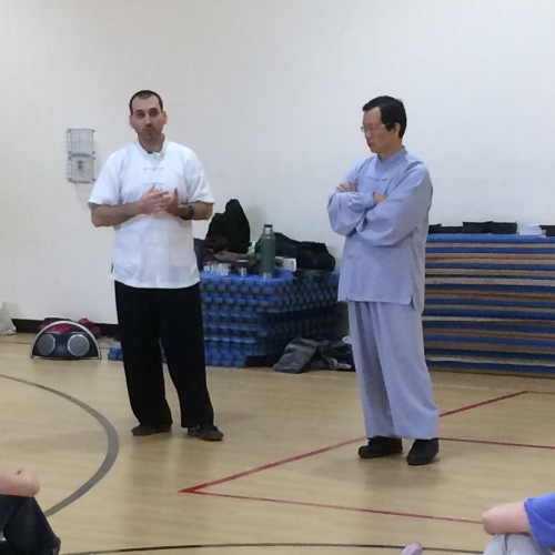 Dr. McCann translating for and assisting his Shifu, Wang Fengming, during a Taijiquan and Qigong seminar (Vermont, 2016).