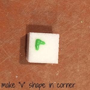 "start with a ""V"" shape on one corner"