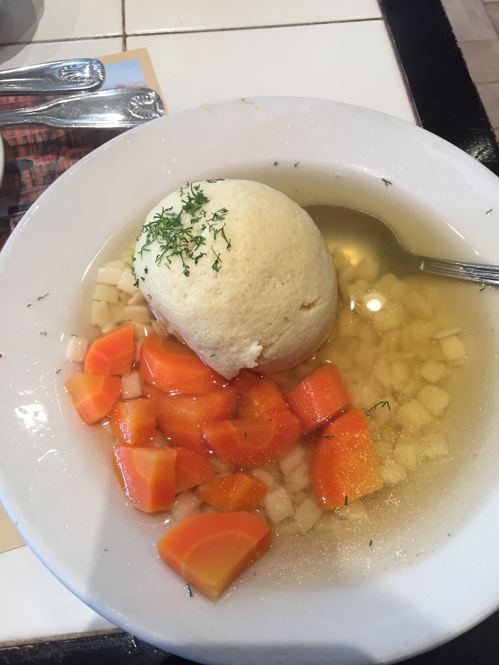 """Jewish Penicillin"" from  2nd Ave Deli . Biggest matzo ball of my life!"