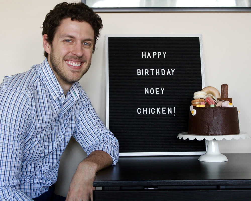 """Being a good sport and posing with the letterboard + cake. My sister gave him the nickname """"Noey Chicken"""" for no particular reason and it just stuck."""