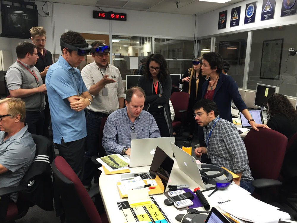 The Mars 2020 scientists and engineers assess data from the rover in the Mars Yard looking for interesting rock features to drill. photo cred:   Matt Heverly  | Courtesy NASA/JPL-Caltech