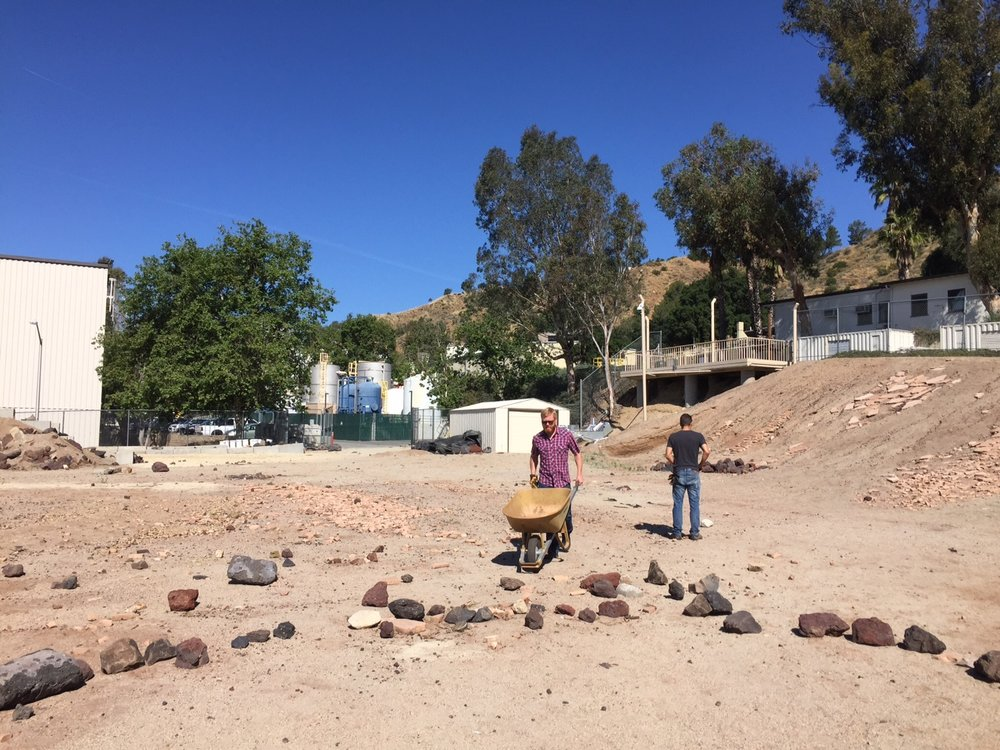 We built an outcrop The Mars Yard at JPL is a designated space for simulating rover behaviors on Mars. For the Design Simulations, we had to carry rocks and assemble an outcrop for our participants to assess during the simulated tactical operations shift.