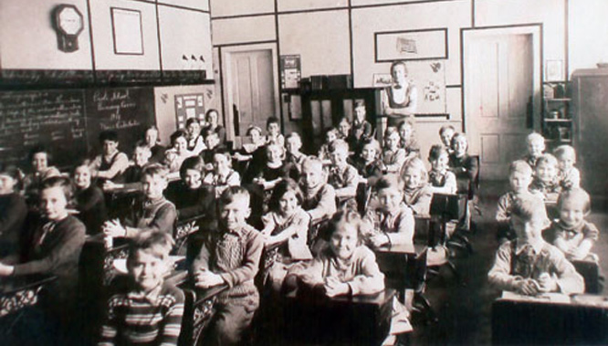 An old photo of the classroom at the Paoli Schoolhouse