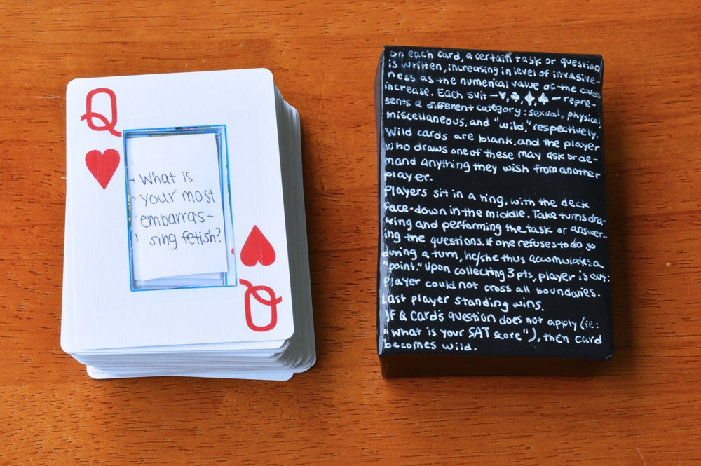 altered standard 52-card deck (paper inserts attached with scotch tape), back of handmade box