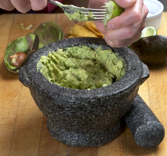 To make guacamole, mash a ripe avocado or two. Add lime juice and sea salt to taste. Optional embellishments include chopped tomatoes, scallions, cilantro, or finely-diced chile peppers.  © Photo courtesy of:  DTR@Ruhlman.com