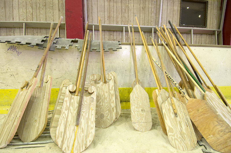 Oars made from wood paneling and old hockey sticks.