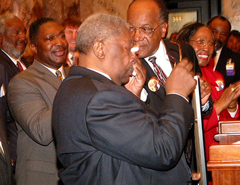 An emotional King is surrounded by Mississippi legislators in Jackson, Miss. as he is presented with a concurrent resolution naming Feb. 15, 2005, as B.B. King Day.    (Photo credit: Mississippi Blues Commission)