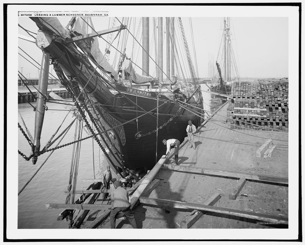Lumber being loaded onto a schooner at the Savannah wharf, c. 1900. Library of Congress
