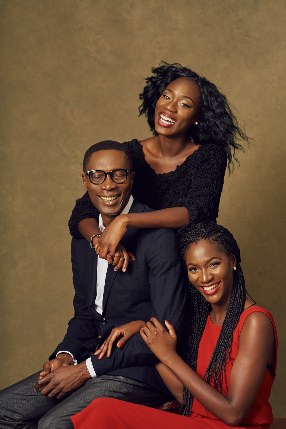 Dr Tony Rapu and his daughters, Uju and Kene Pic Credit: Obi Somto Photography