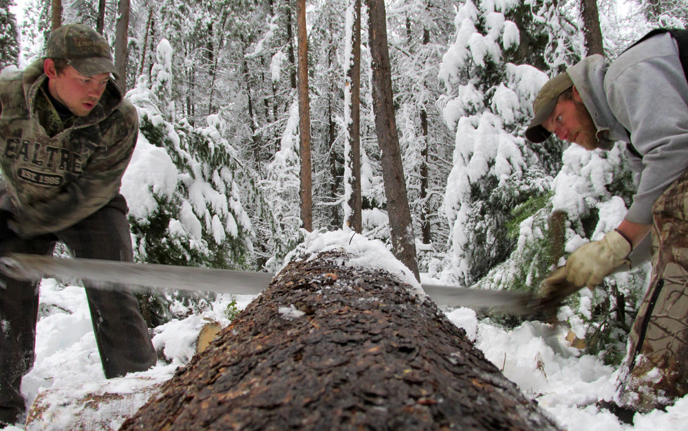 Austin Crane captured this photo of two guides cutting firewood the hard way.