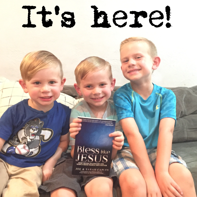 Kaleb, Levi, and Judah holding their favorite book