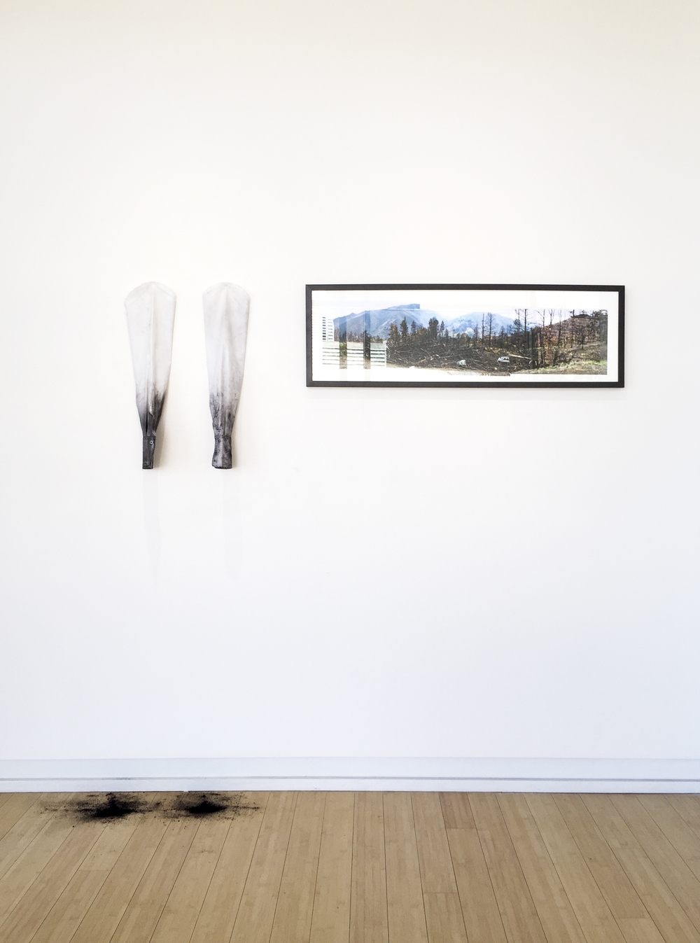Untitled 2015 Cotton sleeves, soot, framed photographs Variable dimensions