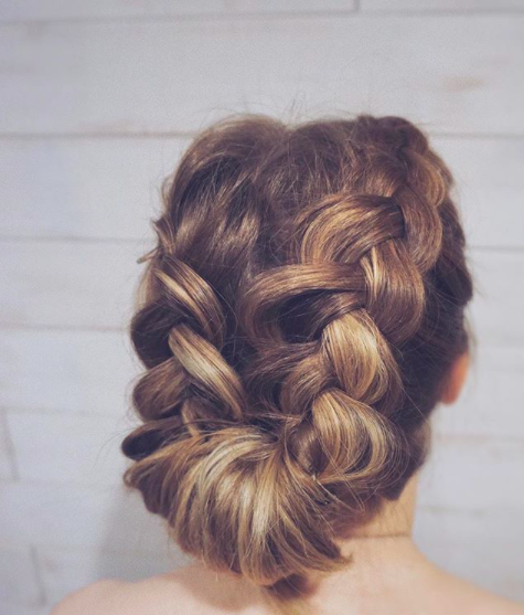 Smooth low bun in the back with braids