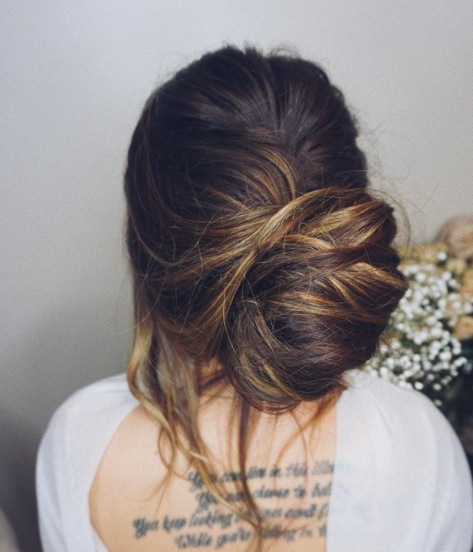 Smooth low bun to the back
