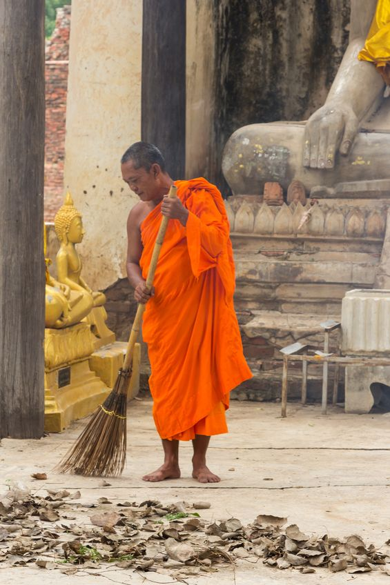 A buddhist monk sweeping