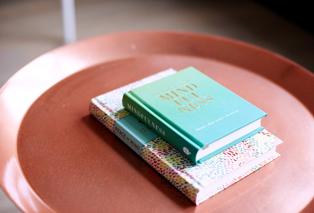 Two mindfulness books on a large round platter