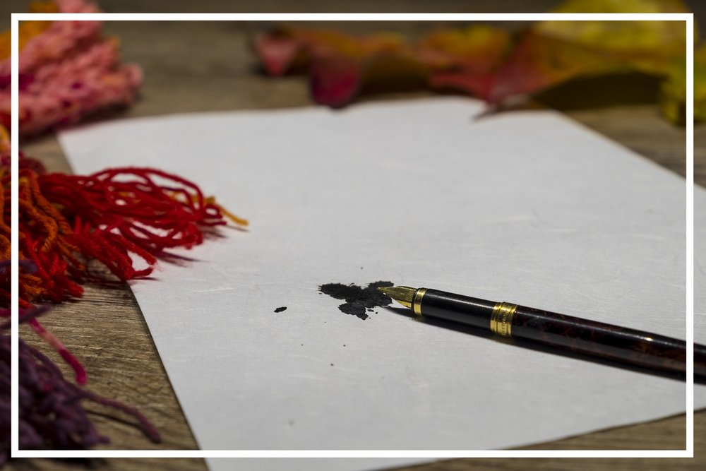Parchment with ink splattered from a fountain pen