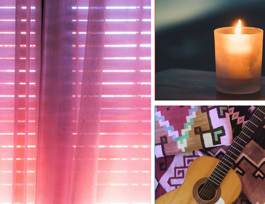 The sun shines through sheer curtains, a candle flickers and a guitar becomes decor in a serene home environment