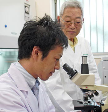 Dr. Ohhira in the Lab with his protégé, Dr. Muneaki Takahata