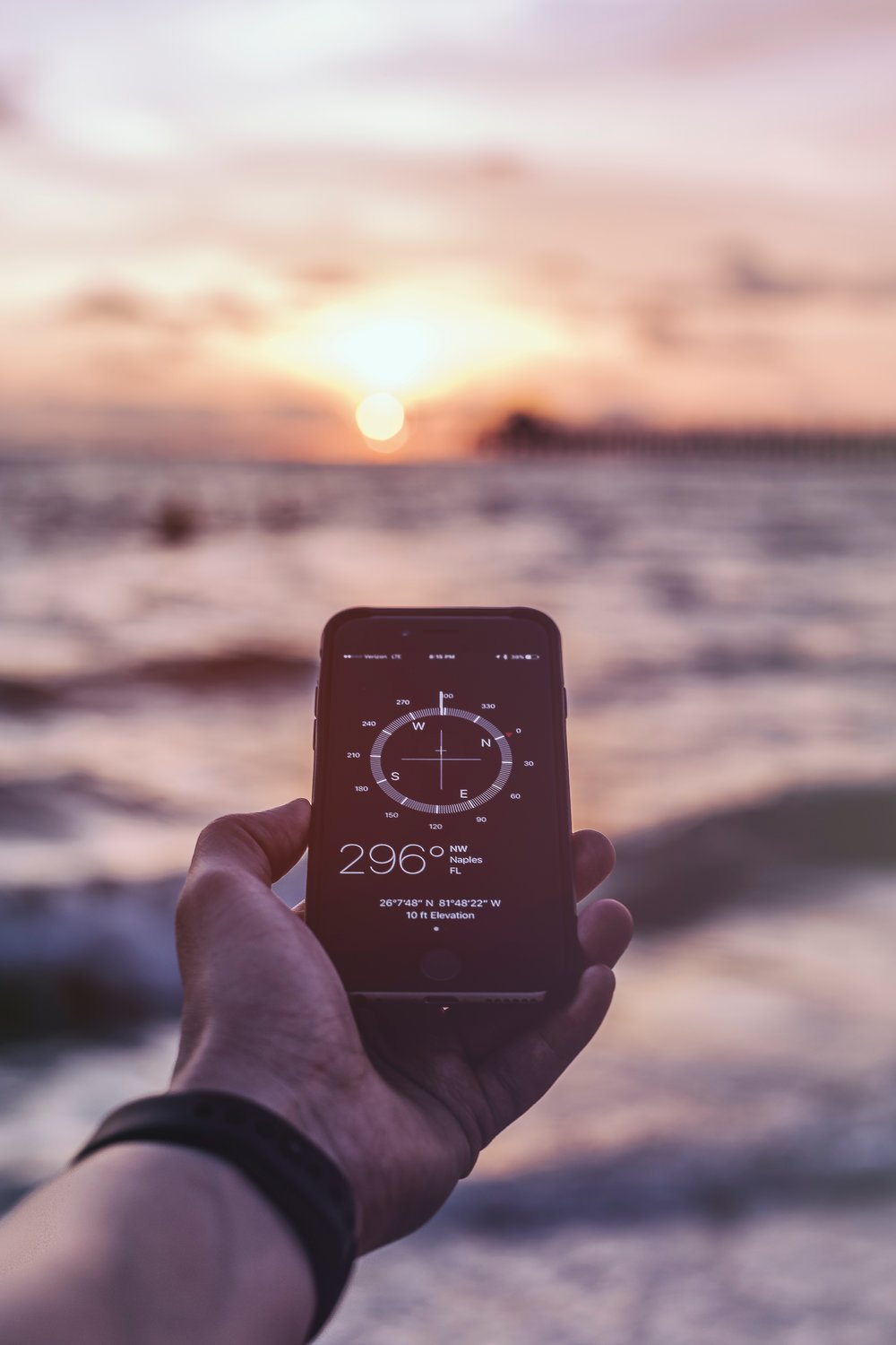 The iPhone compass app is open and pointed toward the sunset