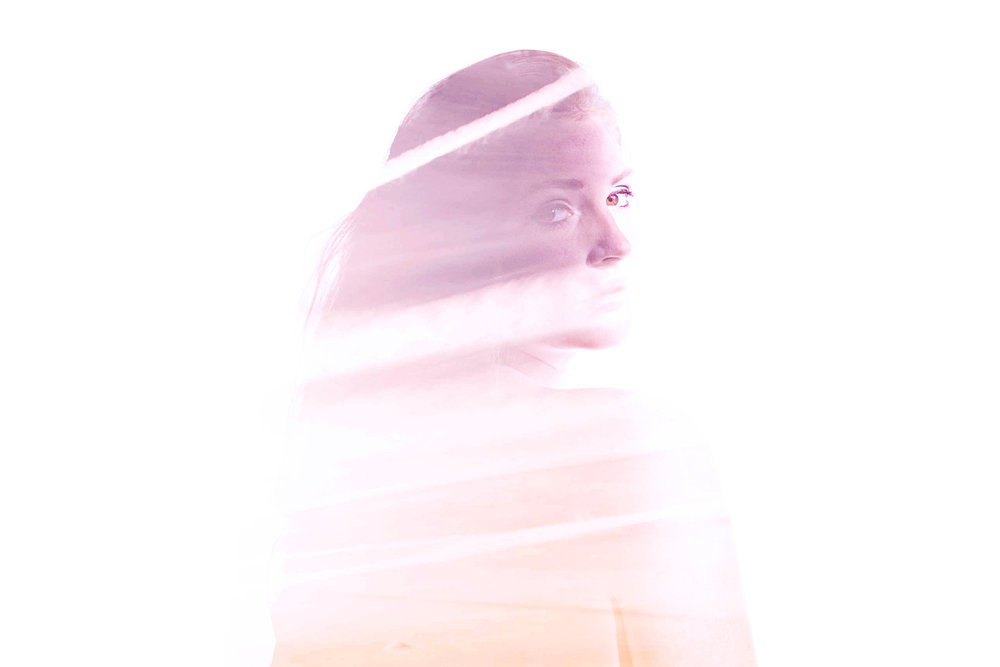 A woman partially shrouded by a light violet and etheric veil