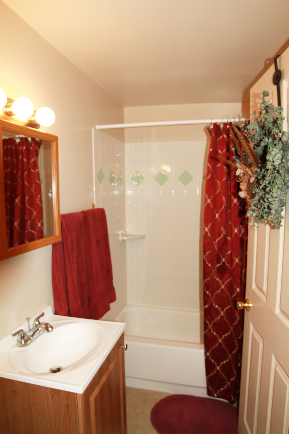 Our bathrooms feature two separate sinks and storage areas, along with a large shower and tub. The tile is new in most of our units!