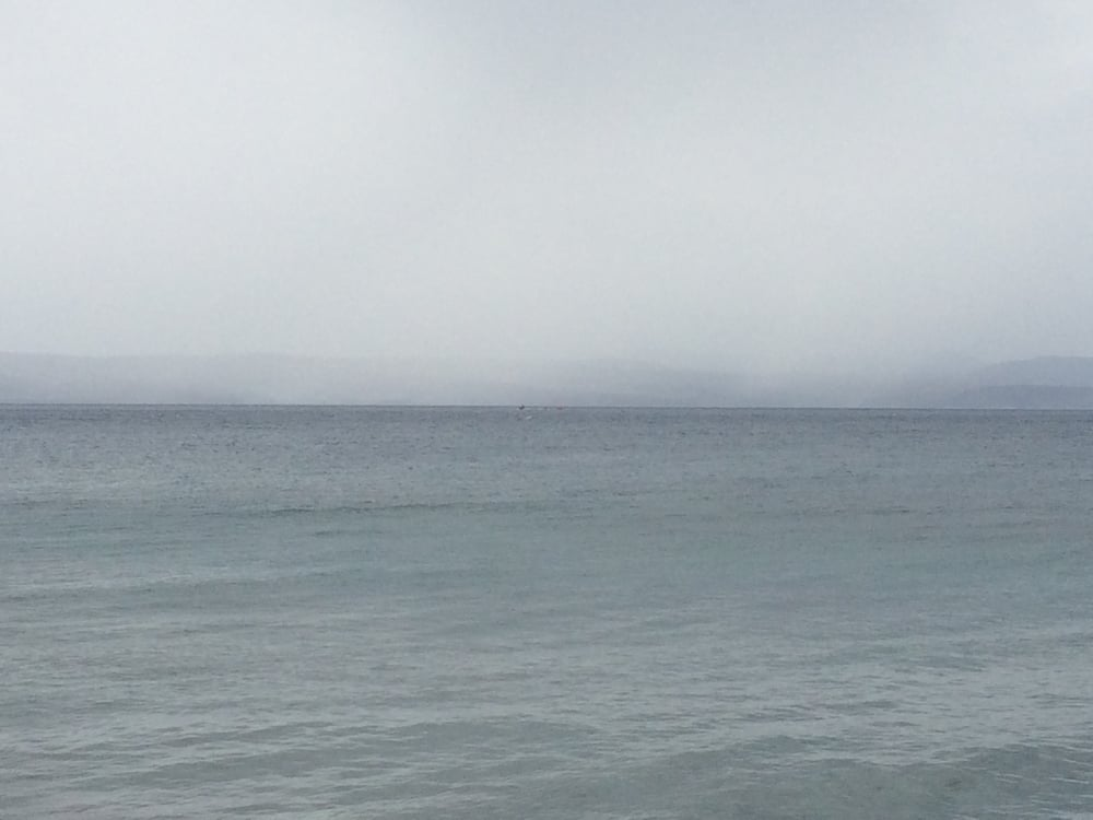 If you look closely (center, horizon), you can see the incoming boat.