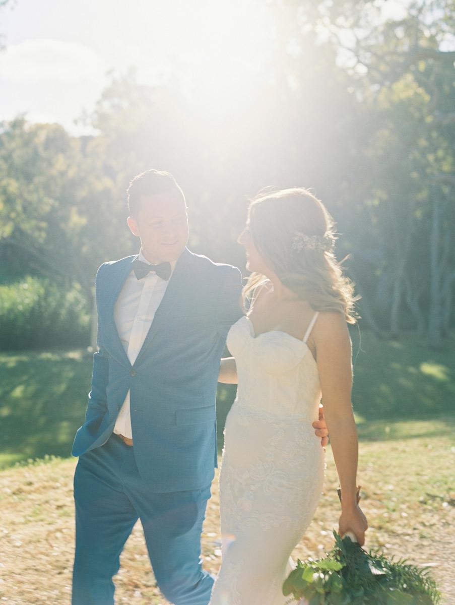 Kingsbrook Estate Wedding by Bentinmarcs Photography couple walking sun flare