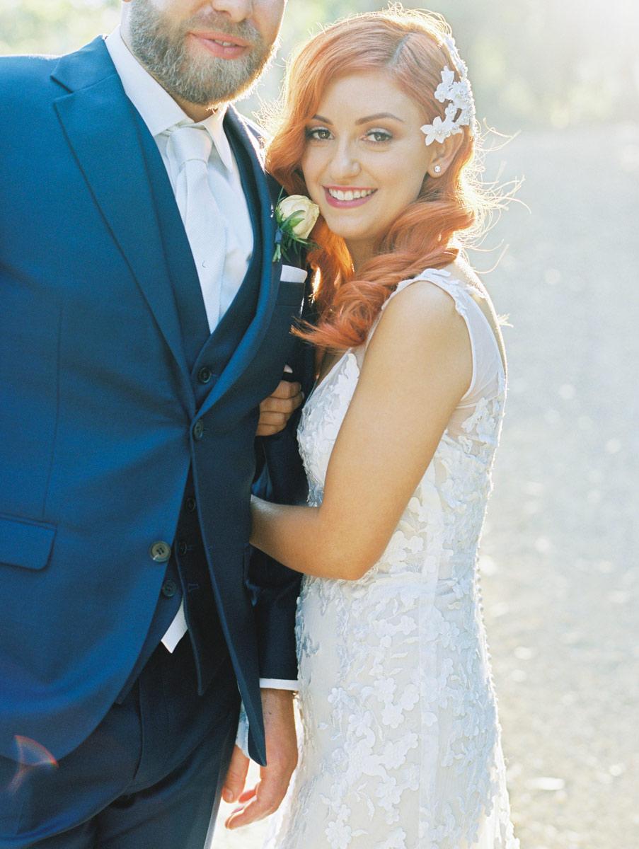 Wedding Adelaide Photographers Bride holding grooms arm