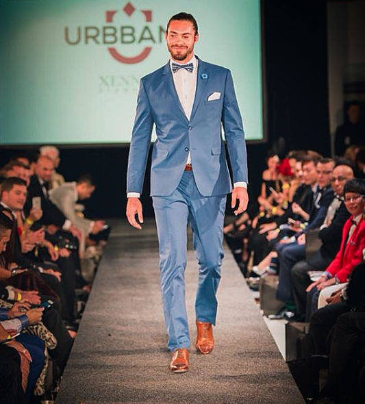 Nick on the catwalk.. man bun looking on point. Picture: Sourced.