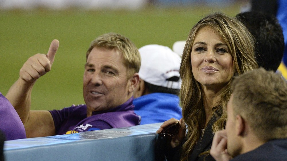 Shane Warne gives the thumbs up up Liz Hurley being a cricket fan... Photo: Getty Images.