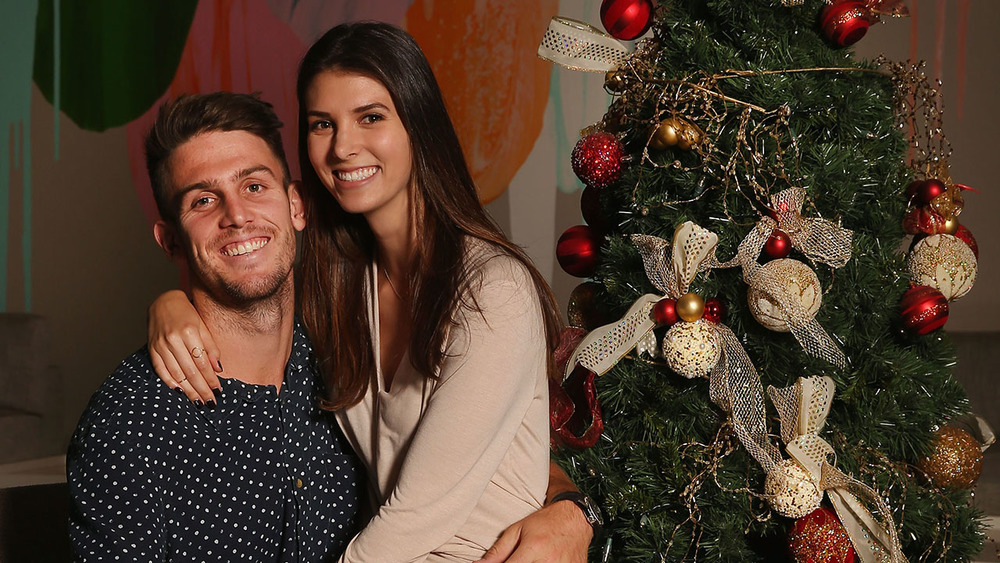 Smiles for miles. Cricketer Mitchell Marsh and Isabelle Platt. Photo: Getty Images.