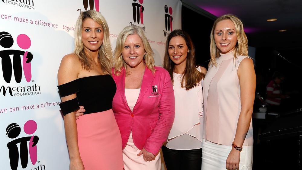 Co-founder of the McGrath FoundationTracy Bevan and the player partners share a moment at the Jane McGrath High Tea. Photo: Getty Images.