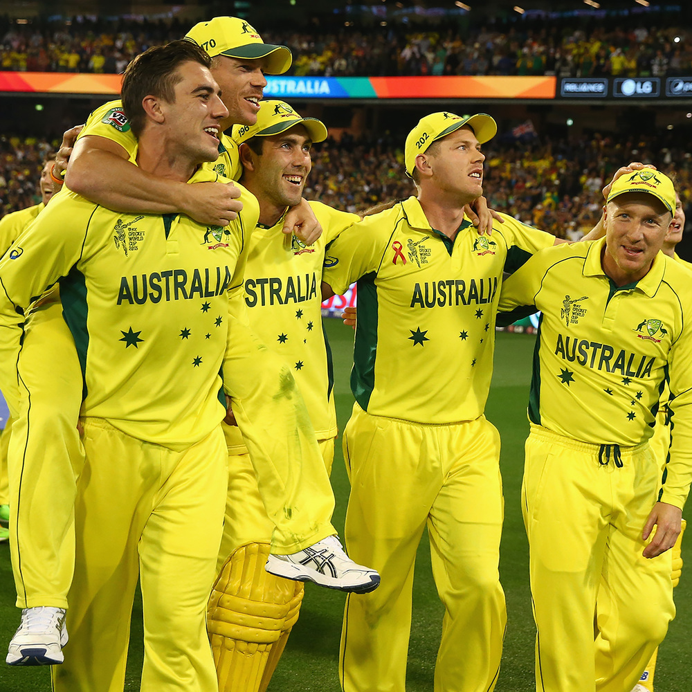 Pat Cummins carries his Australian team mate David Warner off the cricket field, pictured with some of his Australian team mates. Photo: Getty Images.