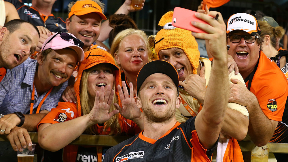 David Willey of the Scorchers poses for a selfie with spectators after winning the Big Bash League match between Perth Scorchers and Sydney Sixers. Photo: Getty Images.