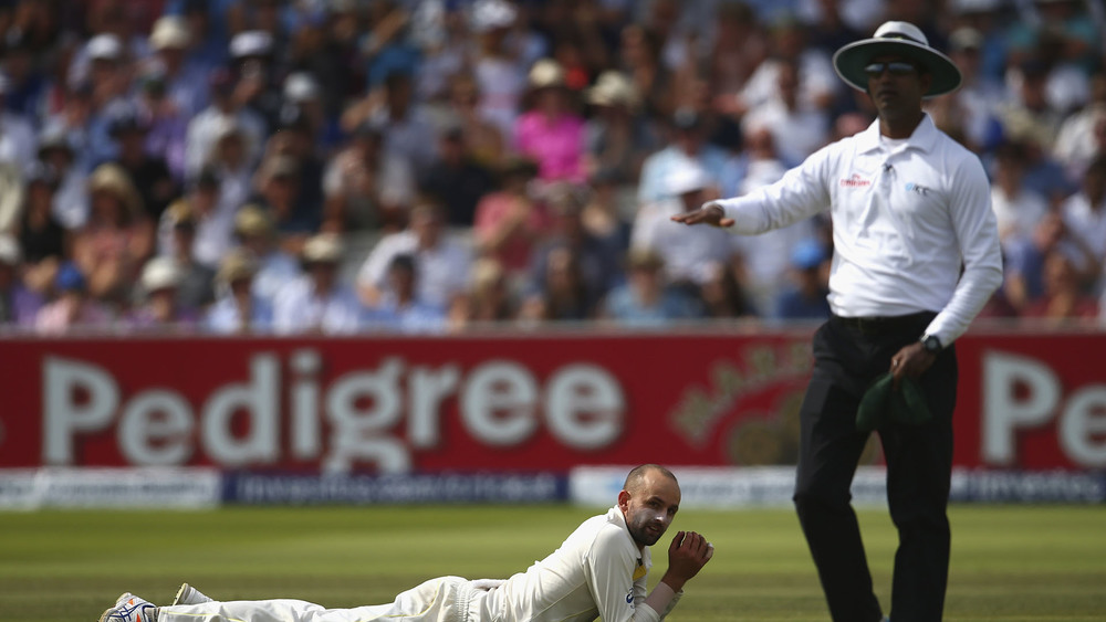 A cricket umpire signals a four with an out the front hand motion. Photo: Getty Images.