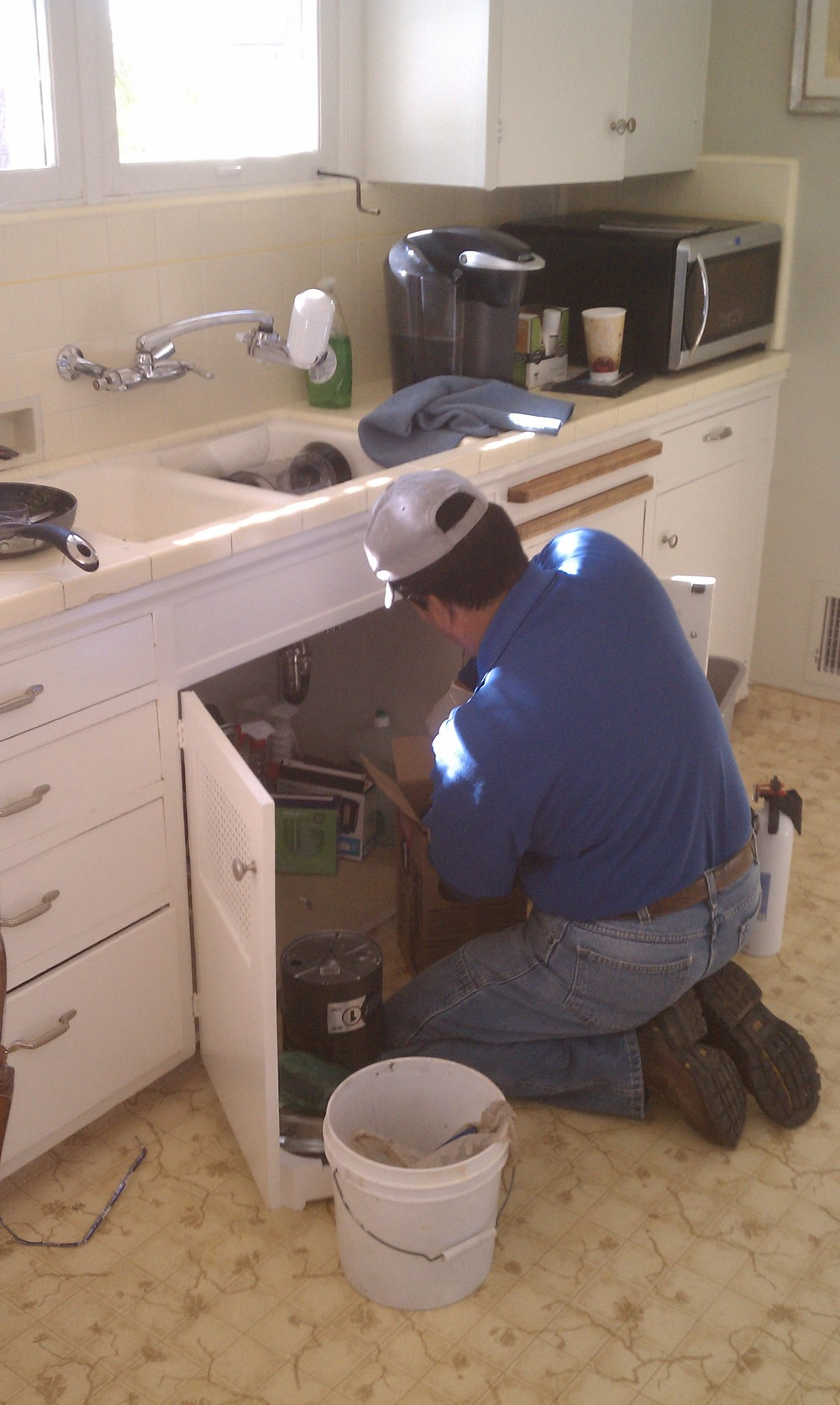 Fixing a garbage disposal and leaky pipes under a sink